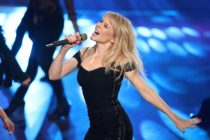 Kylie Minogue performing in a black dress