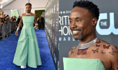 Billy Porter in a green jumpsuit with butterfly tattoos